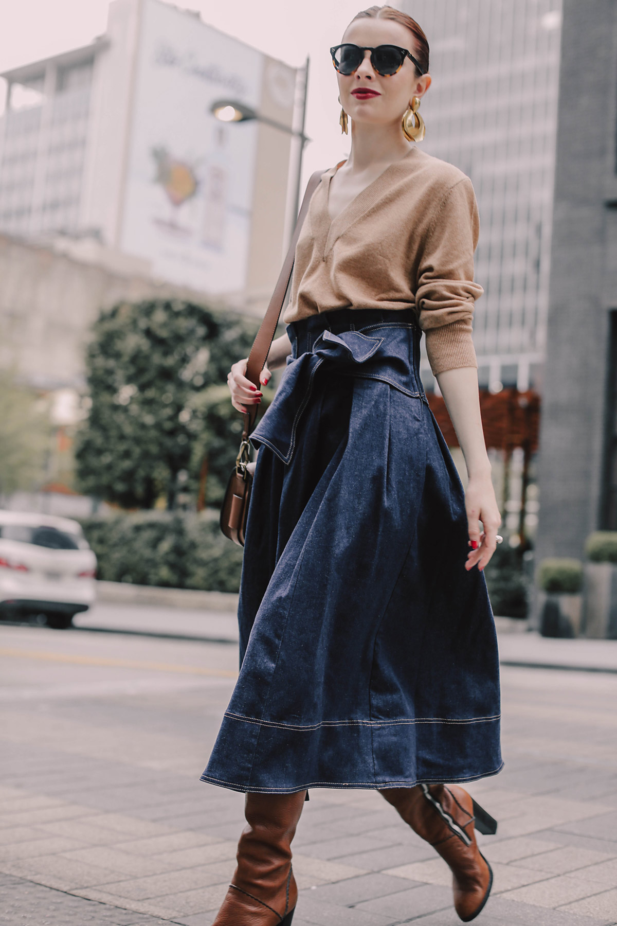 ae3003f04b I fell hard for this denim tie waist Ulla Johnson skirt when I first saw  it. It s a very fresh take on a preppy 70s staple. So chic for fall with a  ...